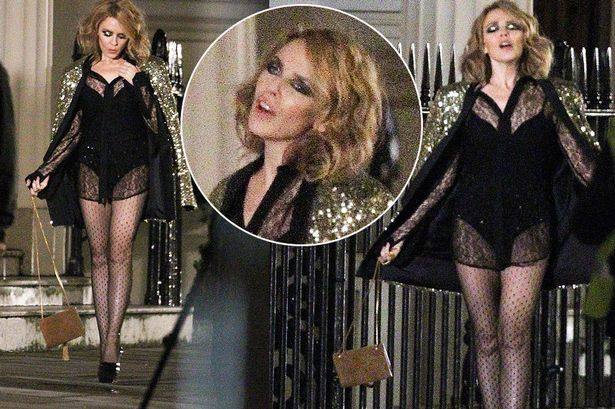 Kylie Minogue shows off her legs on set of music video